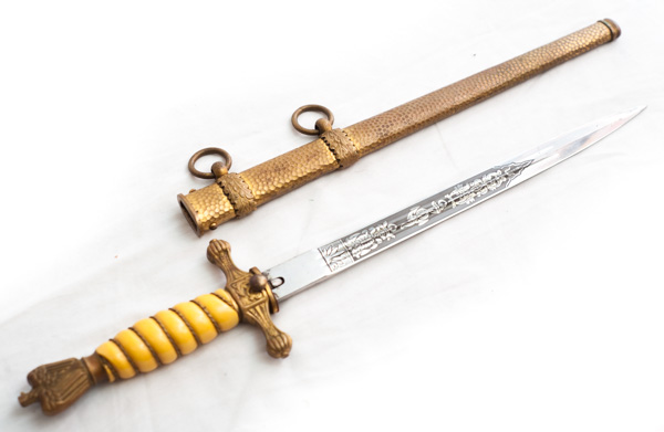 "WW2 German Naval Dagger with pumpkin orange handle. Produced by manufacturer ""WKC""."