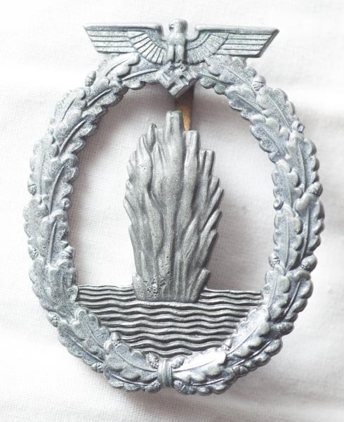 WW2 German mine sweepers badge, with award documentation and U-boat photo.