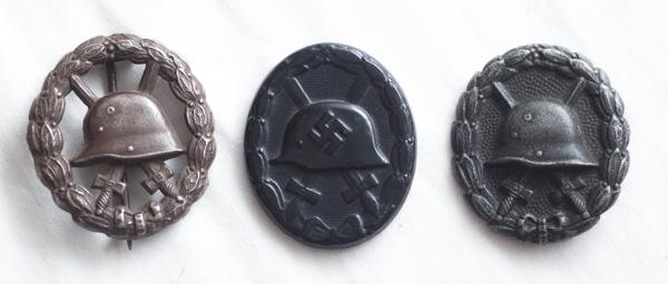 WW1 and WW2 German set of three black wound badges.