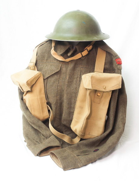 """WW2 1942 dated Canadian infantry battledress, with """"Infantry Corps"""" Insignia on shoulders."""